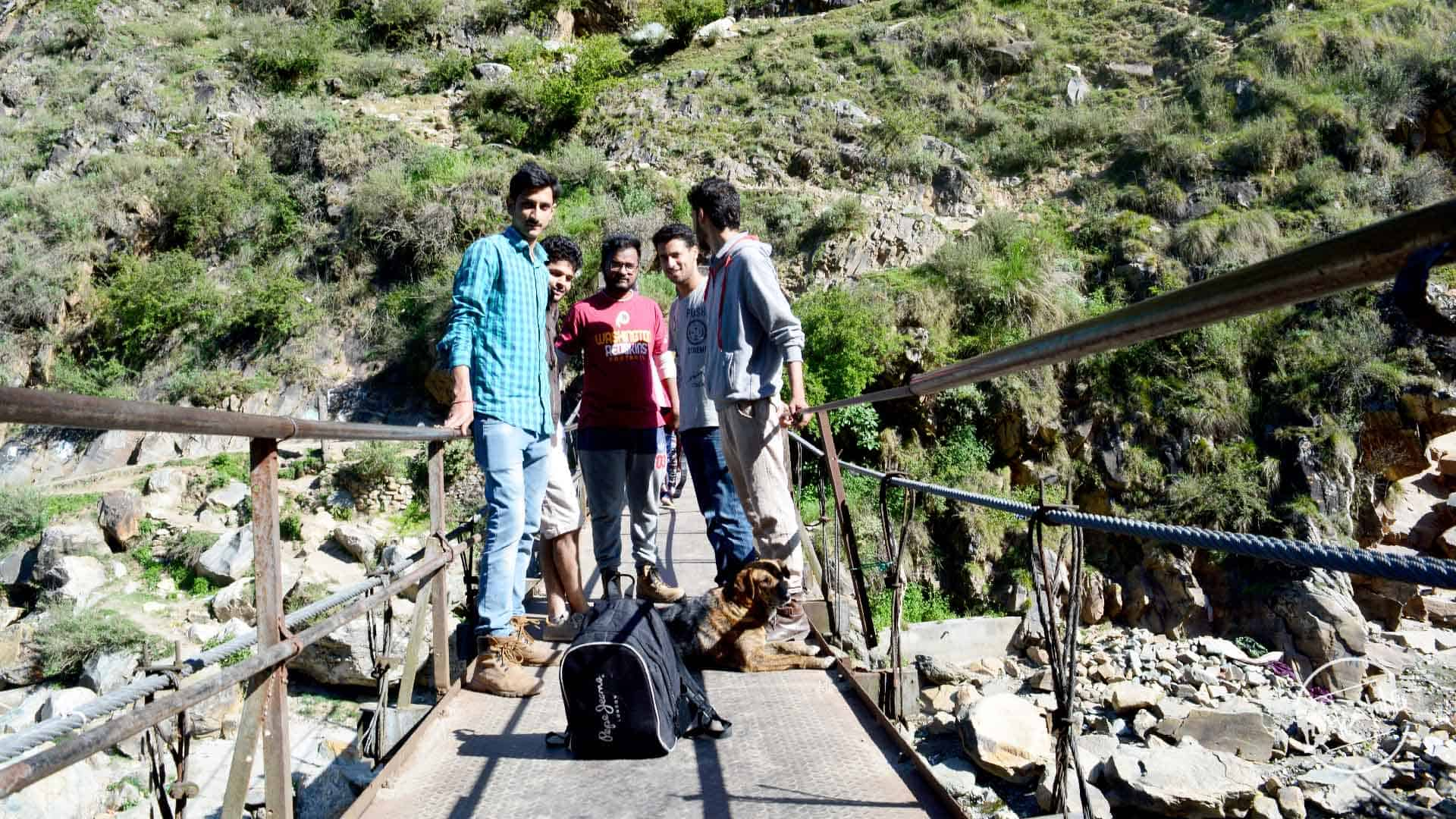 crossing bridge during Grahan Village Trek